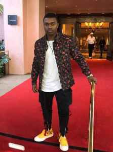 Image: Marc John Jefferies in a red Carpet