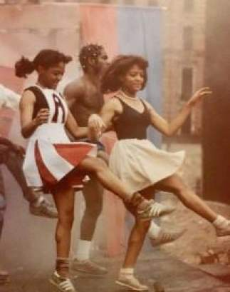 Childhood photo of Lauren Velez while dancing on the stage.