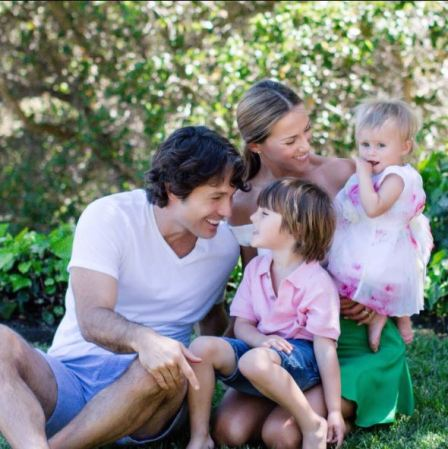 Alec Mazo and his wife, Edyta with their children