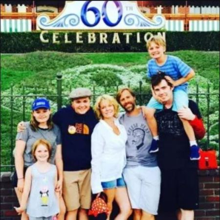 Maura West and her husband with their children.