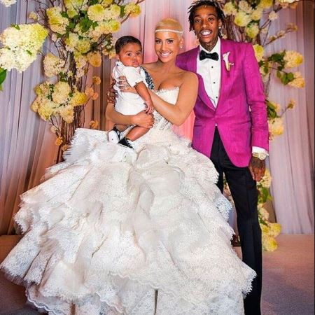 Wiz Khalifa and Amber Rose's son, Sebastian Taylor Thomaz holding him in her arms at their wedding ceremony.
