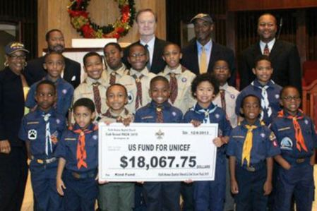 Elizabeth's father, Lawrence O'Donnell accepts K.I.N.D. donation from Cub Scouts pack.