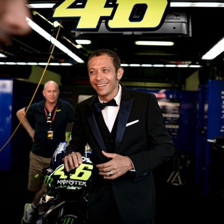 Rossi posing with his racing bike.