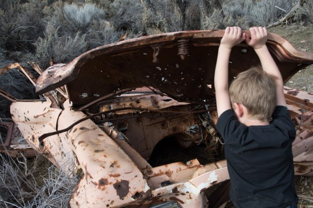 Wrecked car marking the entrance to Lagomarsino Canyon. Photo by David Calvert