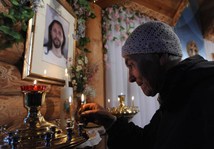 Woman Praying To The Siberian Jesus
