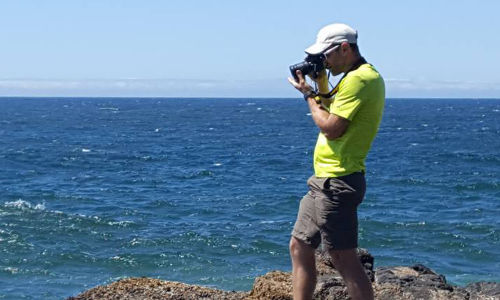 Gabe Taking photos by the ocean