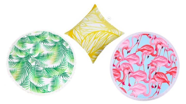 Round beach towels in palm leaves and pink flamingos. Yellow palm leaf pillows