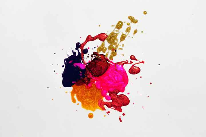 Splashes of paint colors, in deep purple, red, hot pink, orange and gold