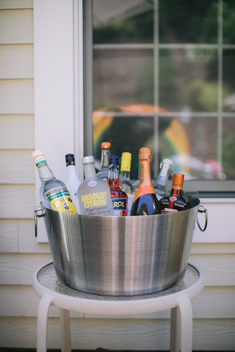 A Large Ice Bucket filled with Assorted Liquors for How-To: Make a Self Serve Bar