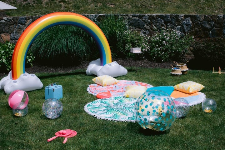 Lounge Area on Lawn using Round Fringe Beach Towels in Flamingo, Tropical Leaf and Colorful Beach Ball Pattern with Lawn Games and Inflatable Glitter Beach Balls