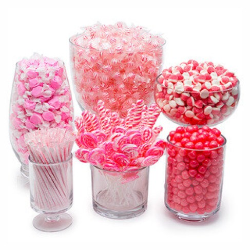Candy Warehouse is one of my Most Loved Sites for Children's Parties. Pictured: Pink and white candy display in vessels of varying heights.