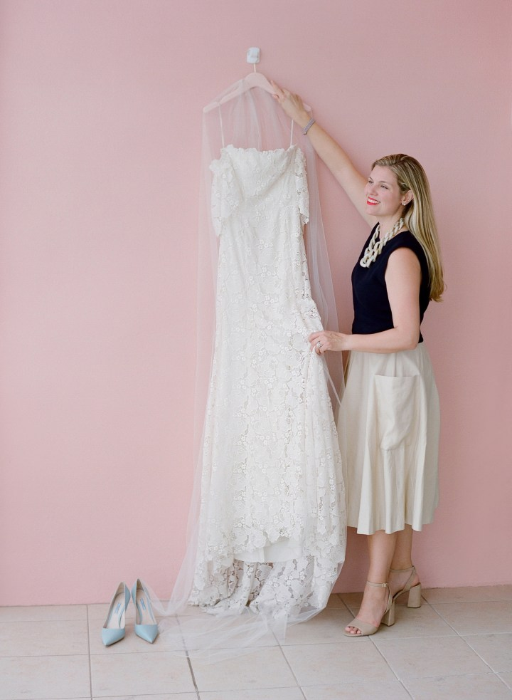 Julie Sabatino, The Stylish Bride, holding a lace wedding gown