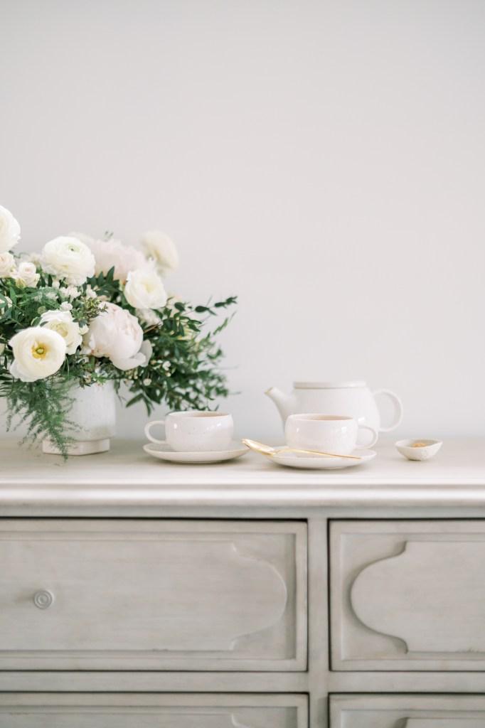 Coffee on table near flowers