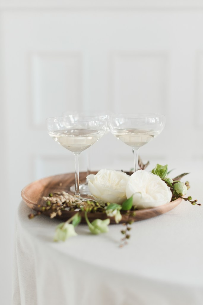 Champagne glasses against neutral background