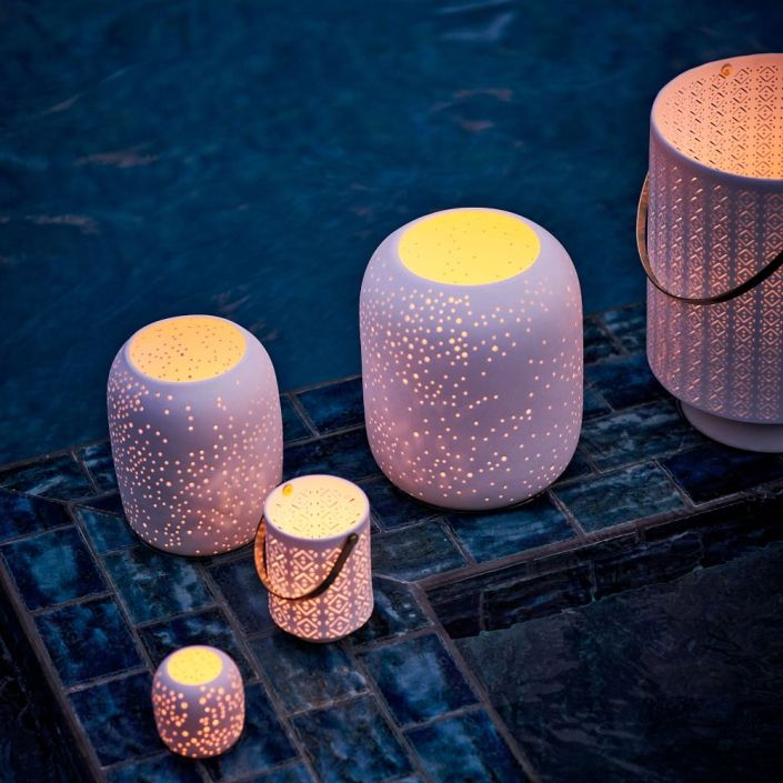 Larger candle holders with small holes on the sides for the light to shine through