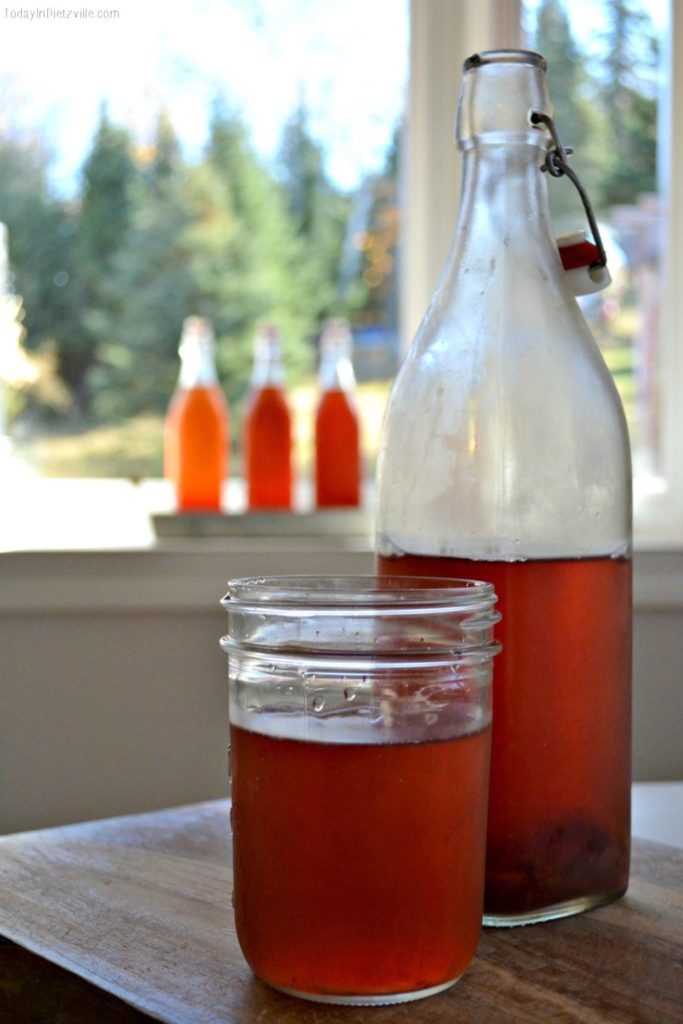 How To Flavor Kombucha With Frozen Fruit | Drinking ferments is one of the tastiest and easiest ways to maintain a healthy gut. Learn how to flavor kombucha with frozen fruit -- the flavor combinations are ENDLESS! And you don't have to worry about your favorite fruit being out of season! | AllTheNourishingThings.com