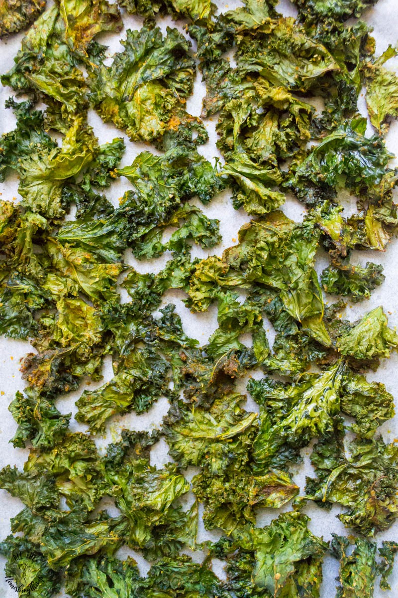 dairy-free and vegan chipotle kale chips on parchment paper
