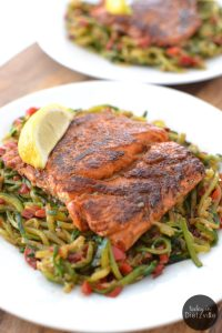 Me + spicy, Cajun food = true love. Here's a Paleo, Whole30 version of a classic Cajun favorite -- Blackened Salmon Over Cajun Zoodles in just 1 skillet! Get those brain-healthy Omega 3s and blood sugar-friendly fiber from the zucchini noodles!