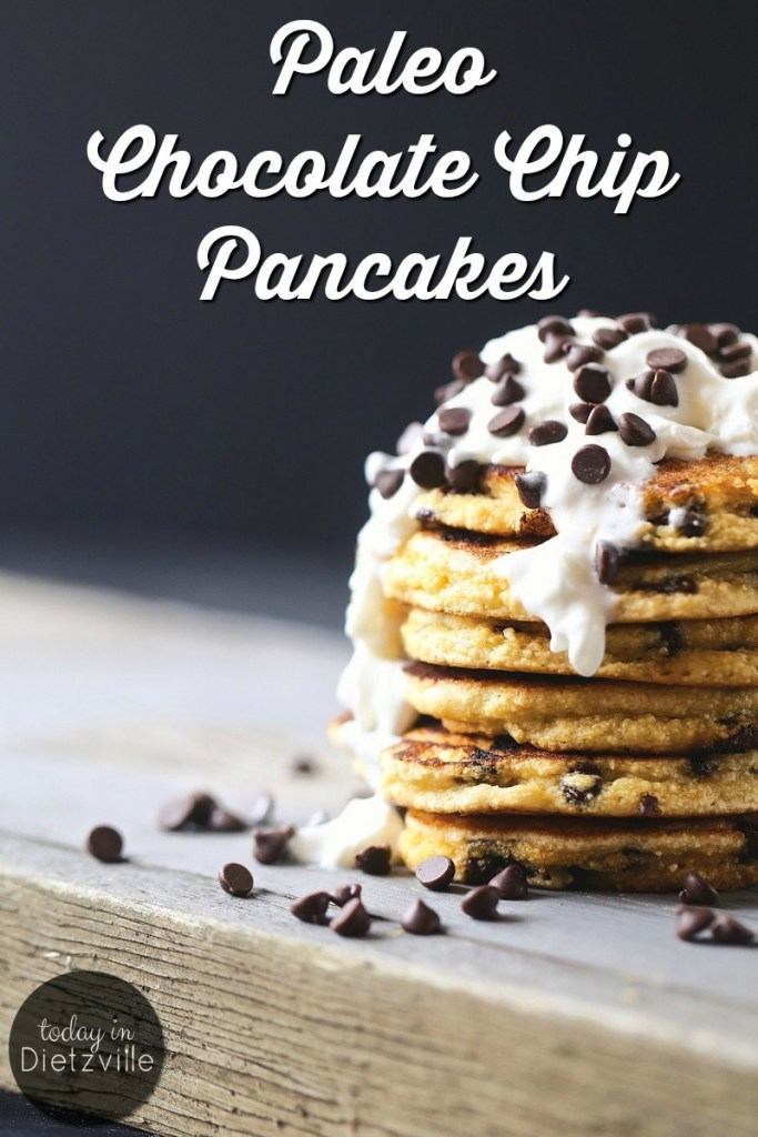 stack of chocolate chip pancakes topped with whipped cream and chocolate chips