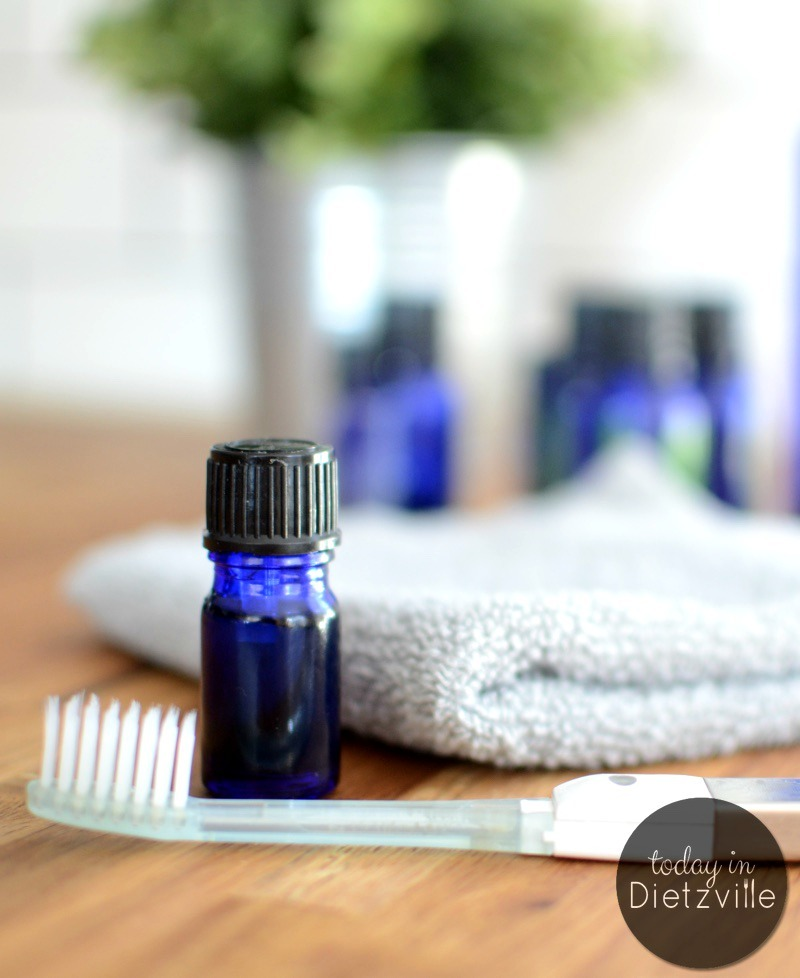 cobalt blue bottle with toothbrush