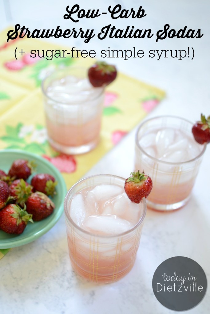 3 Low-Carb Strawberry Italian Sodas on bright table with fresh strawberries