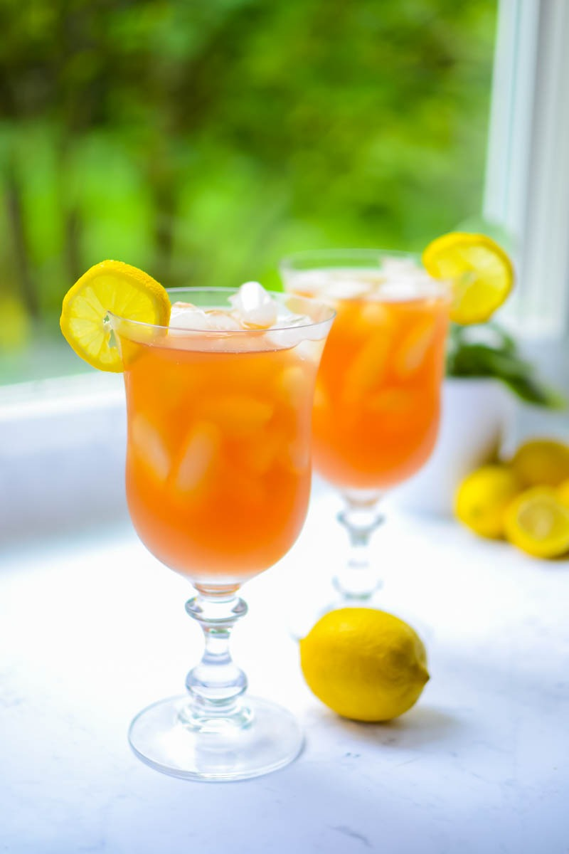 7bfeb9857 2 glasses of low-carb keto arnold palmer iced tea garnished with lemon  slices