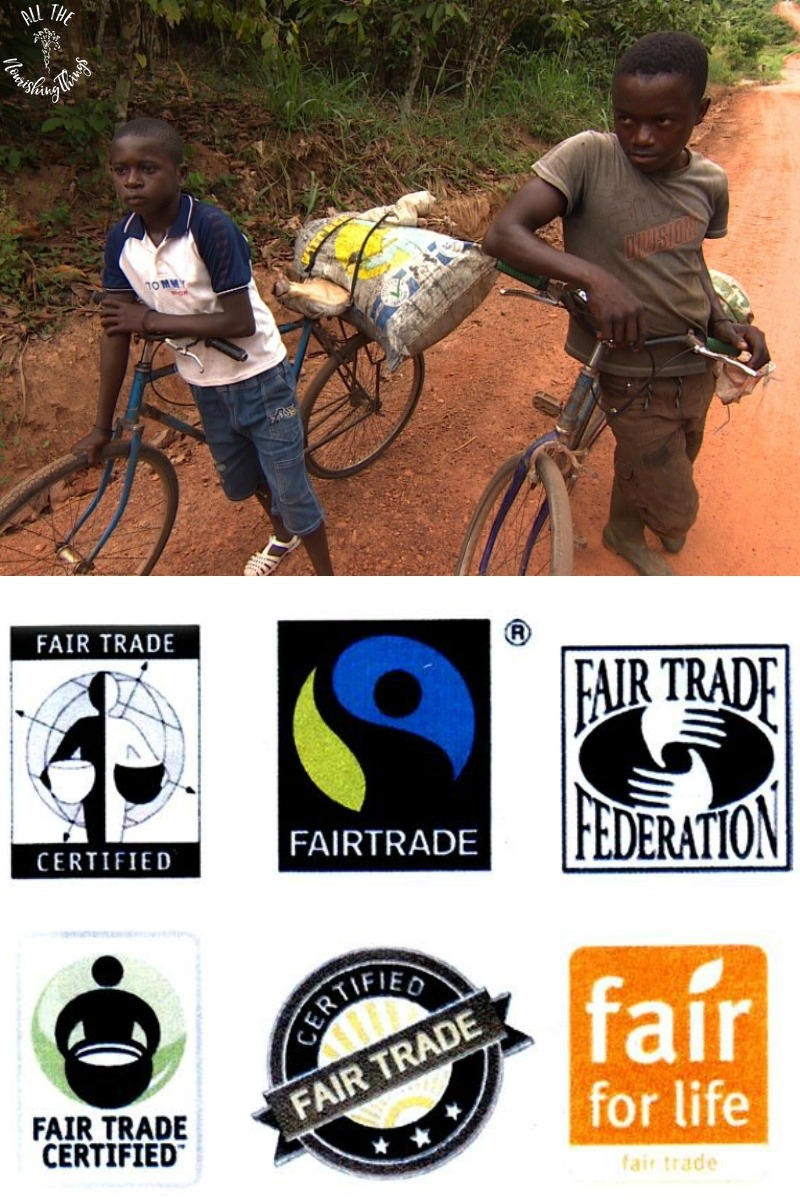 african children on dirt road with bikes and fair trade symbols