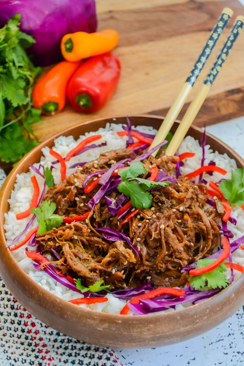 wooden bowl of sweet 'n spicy asian pulled pork made in instant pot