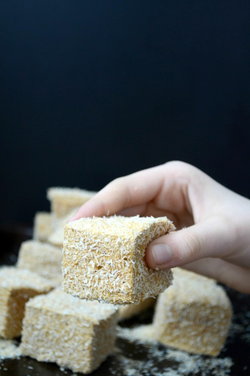 hand holding salted caramel marshmallow covered in toasted coconut