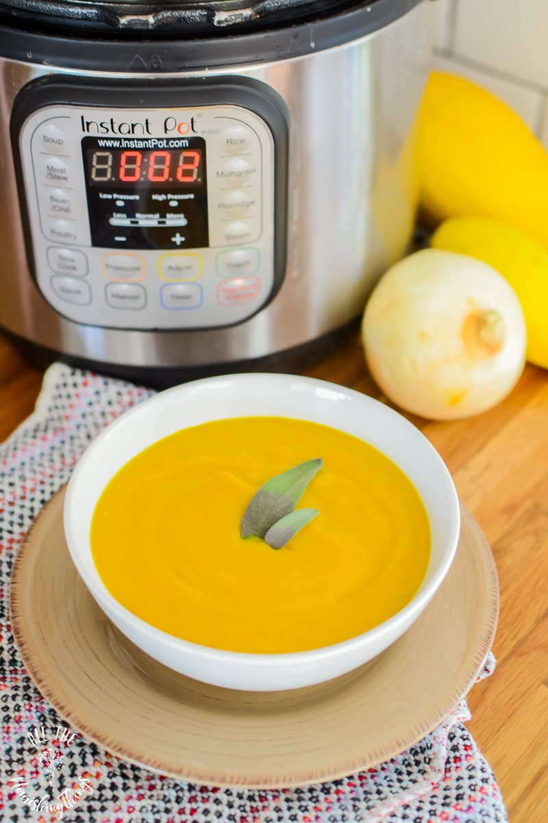 instant pot with yellow blended soup