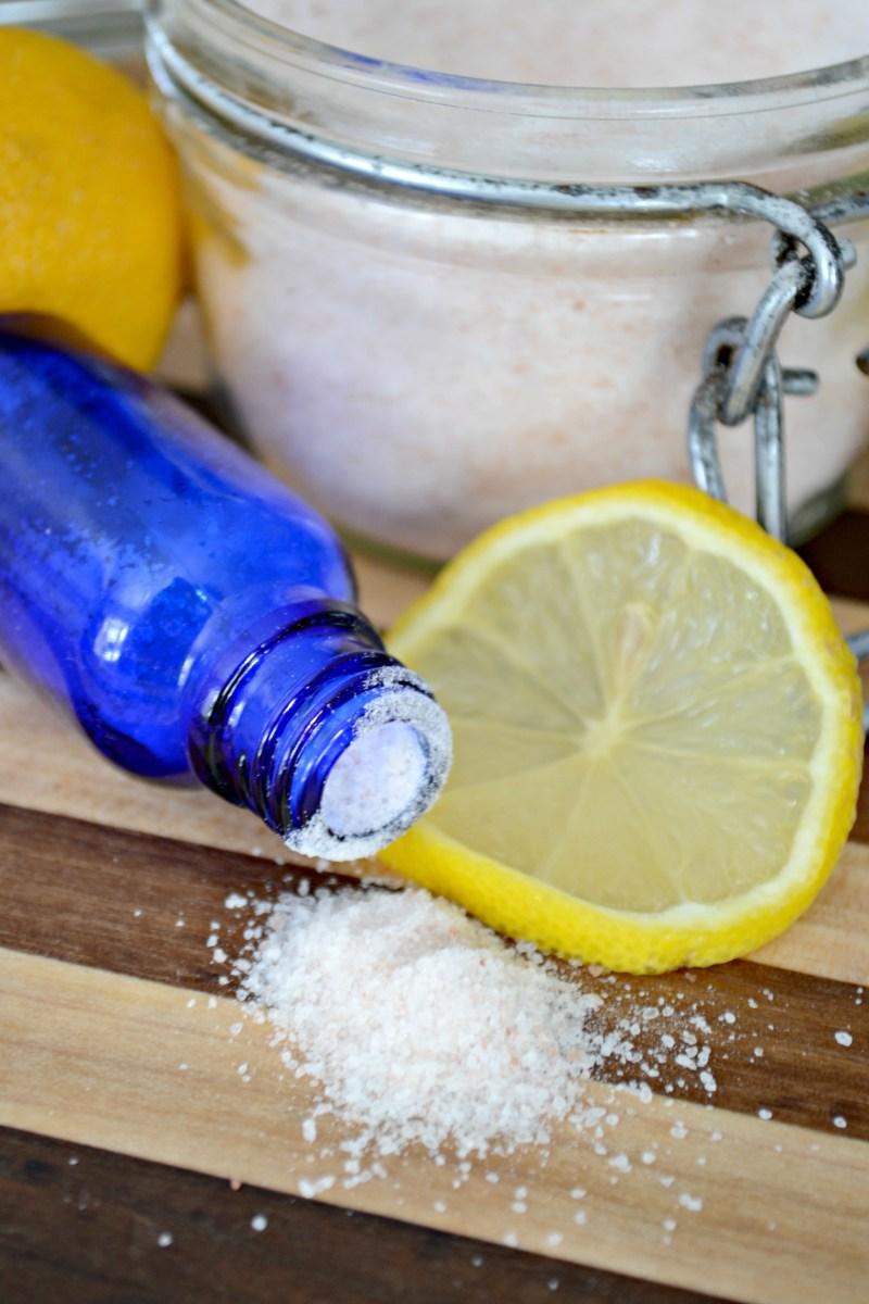 cobalt blue bottle with salt and lemon slices for essential oil flavored salt