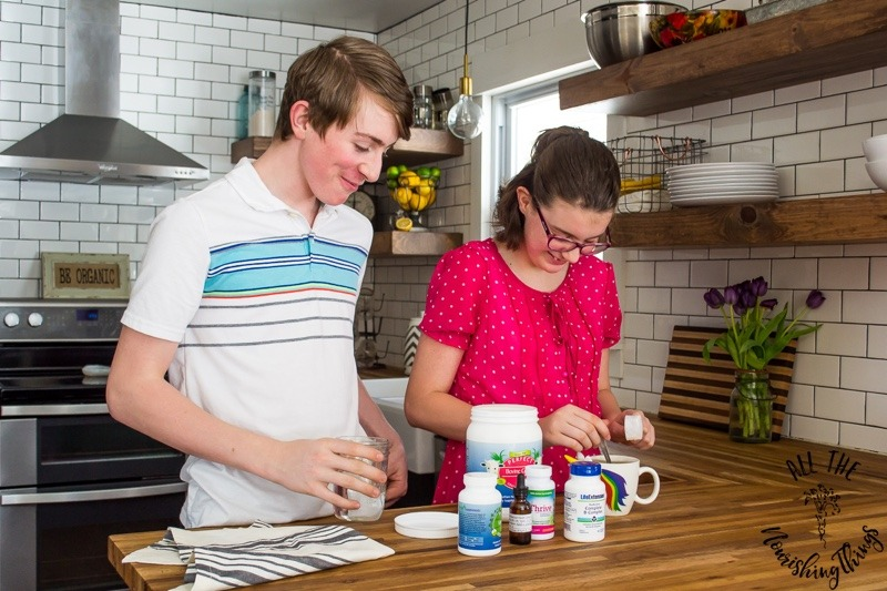 must-have supplements for teenagers with teenagers laughing and taking supplements