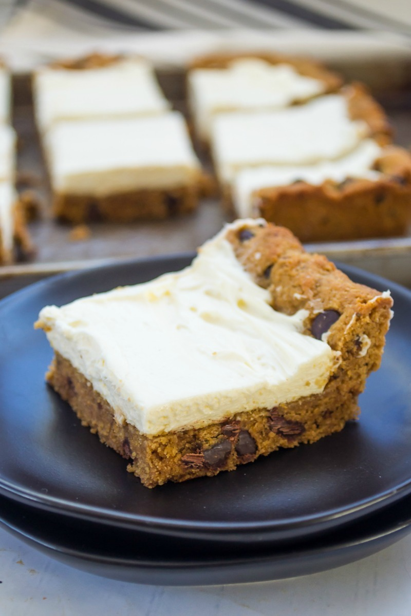 chocolate chip cookie cheesecake bar on black plate