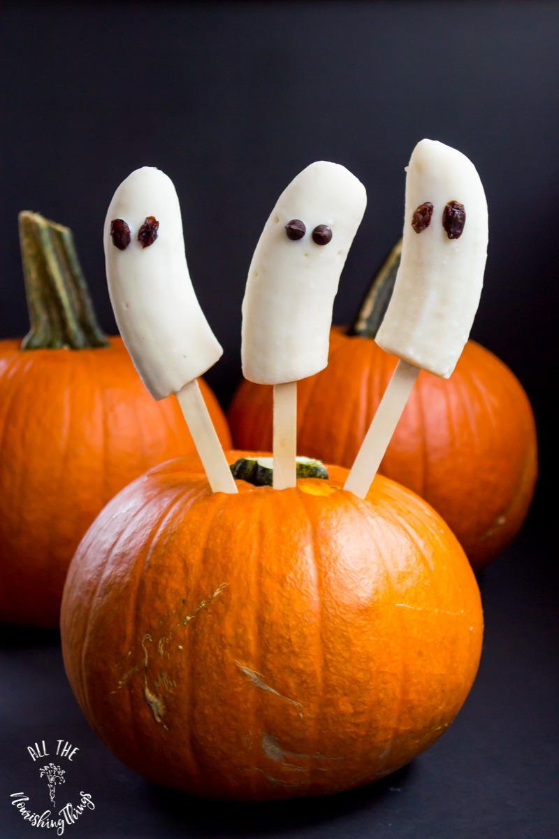 3 banana ghosts sticking out of pumpkin