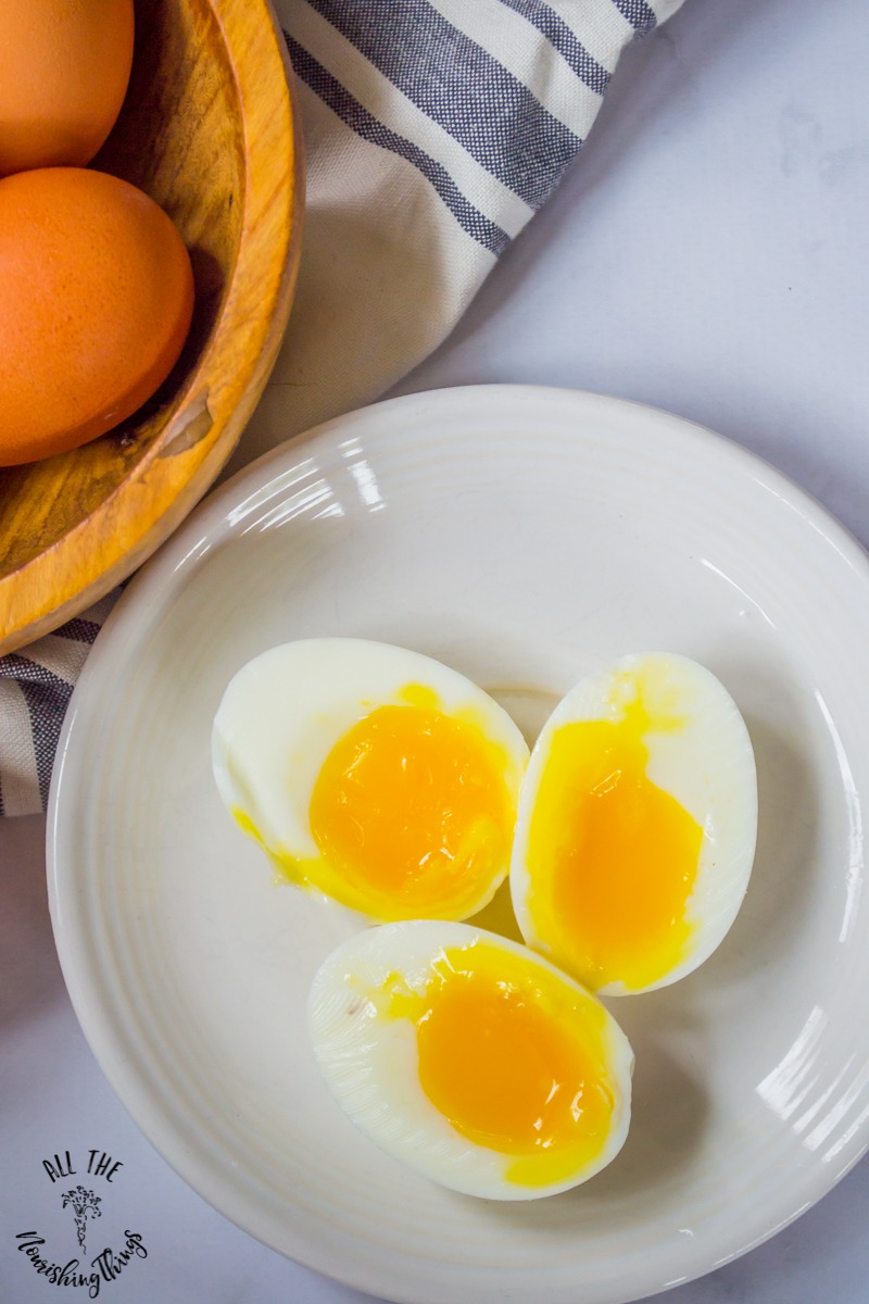 white plate with 3 instant pot soft-boiled eggs