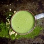 mug of bright green matcha moringa white hot cocoa