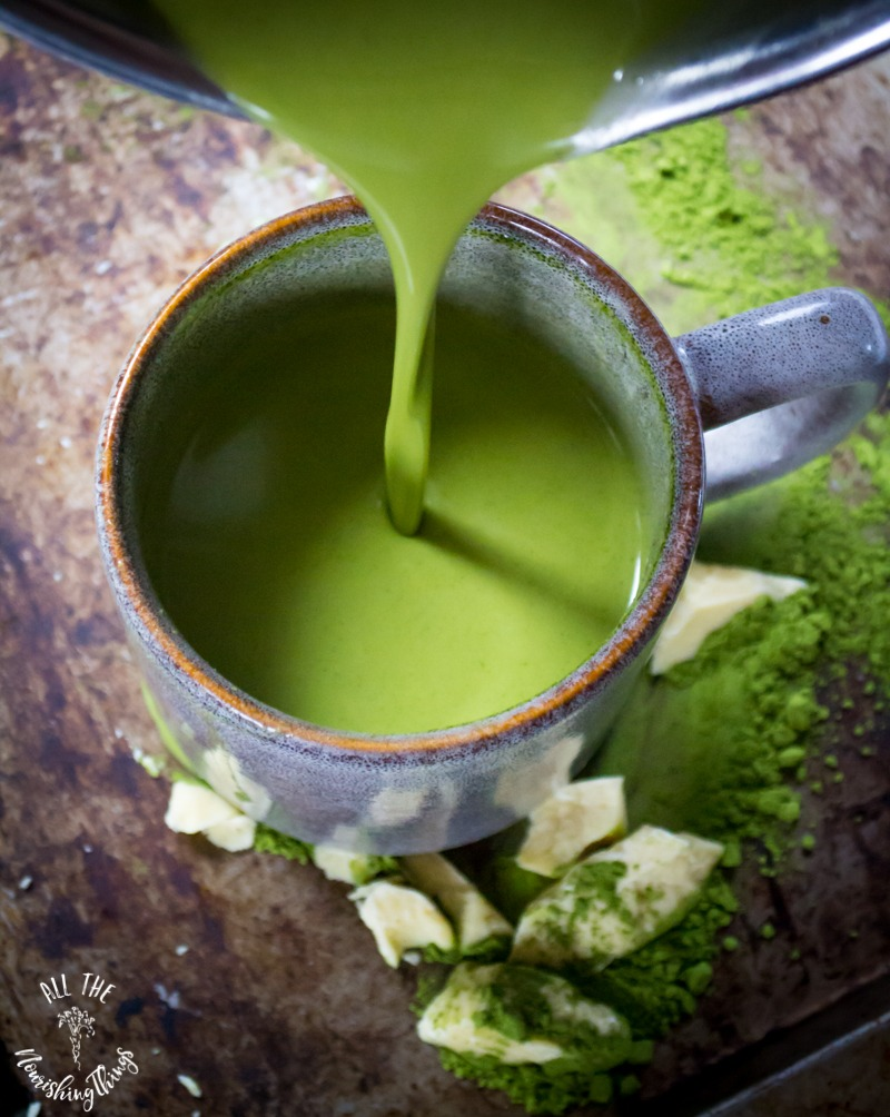 pouring moringa-matcha white hot cocoa into mug