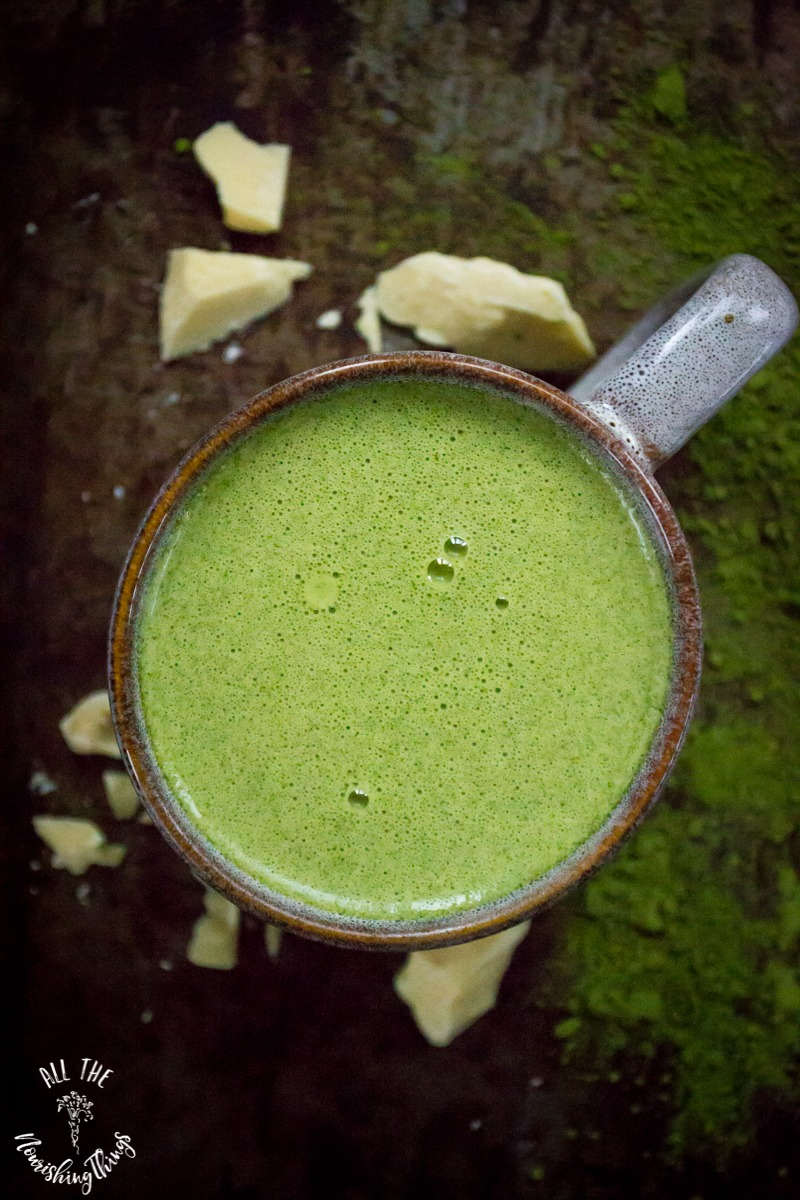 vertical photo of mug of green matcha-moringa white hot cocoa