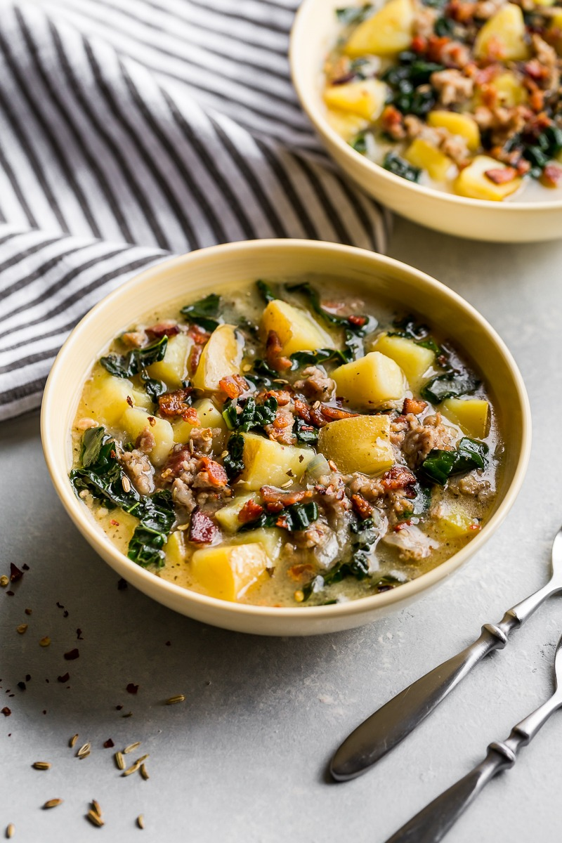 bowl of instant pot zuppa toscana soup with potatoes and kale