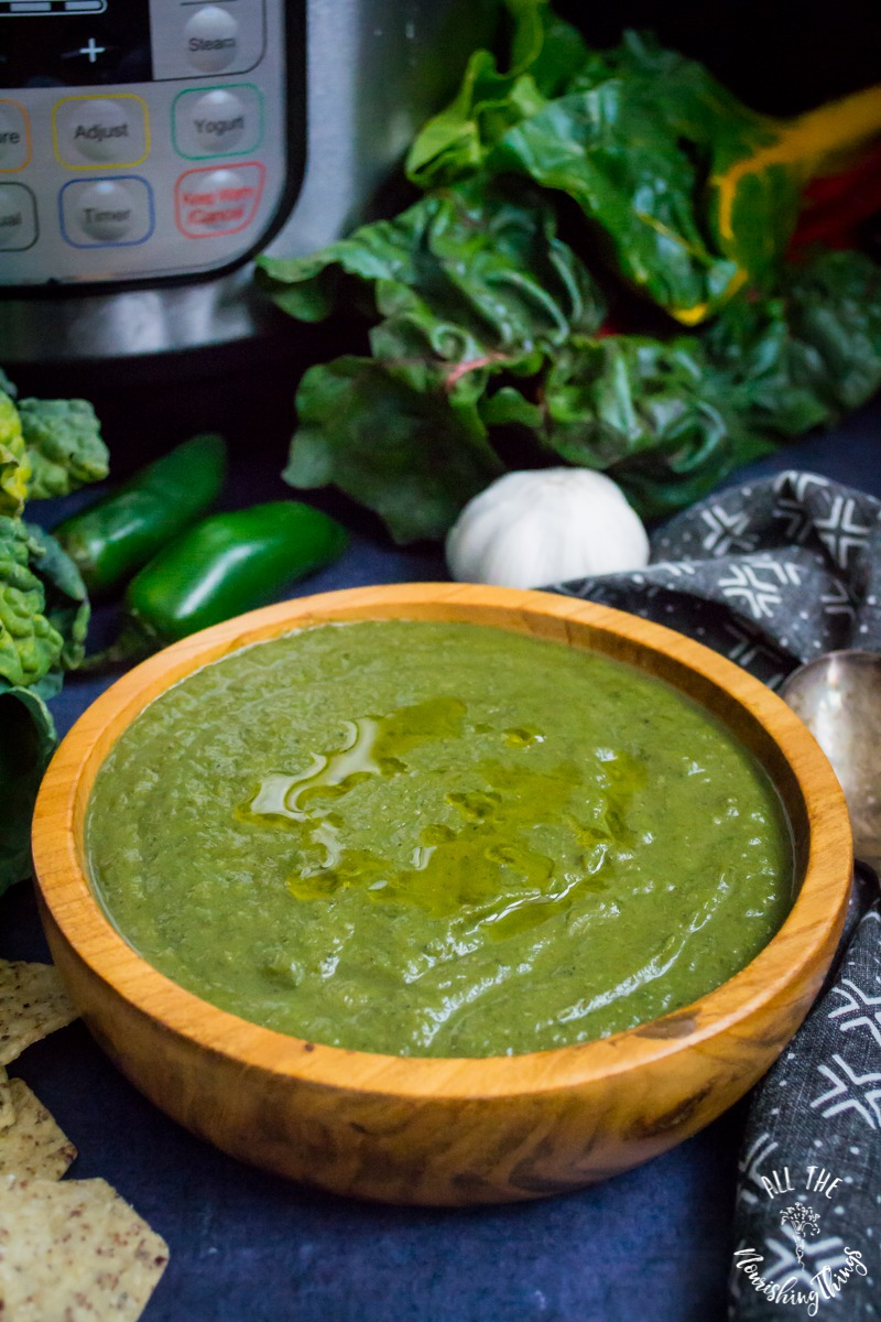 instant pot green soup in wooden bowl with instant pot and greens in background
