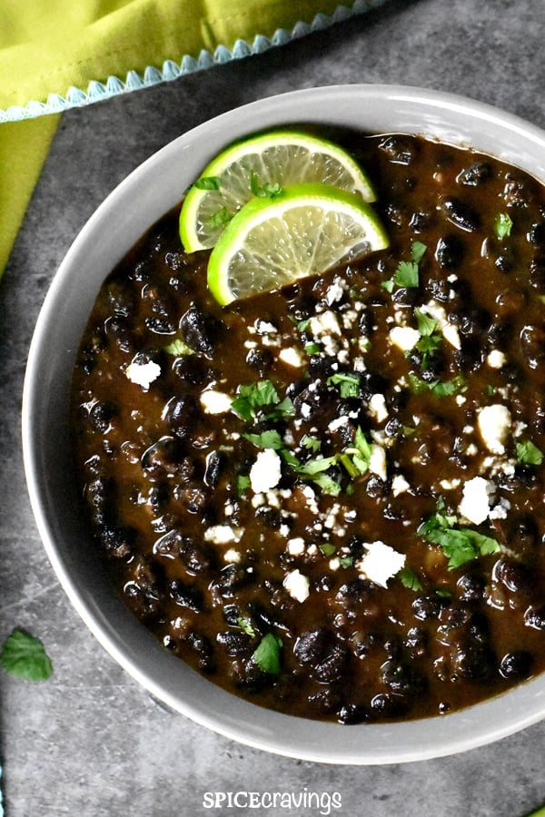mexican instant pot black beans garnished with lime slices