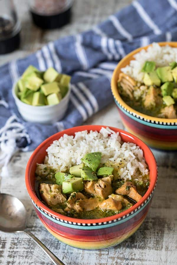 instant pot asopado with rice in colorful bowls