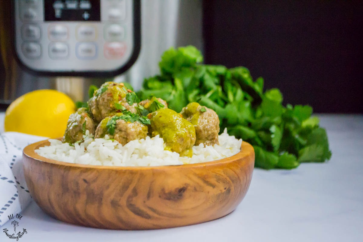 wooden bowl of basmati rice topped with instant pot cilantro meatballs