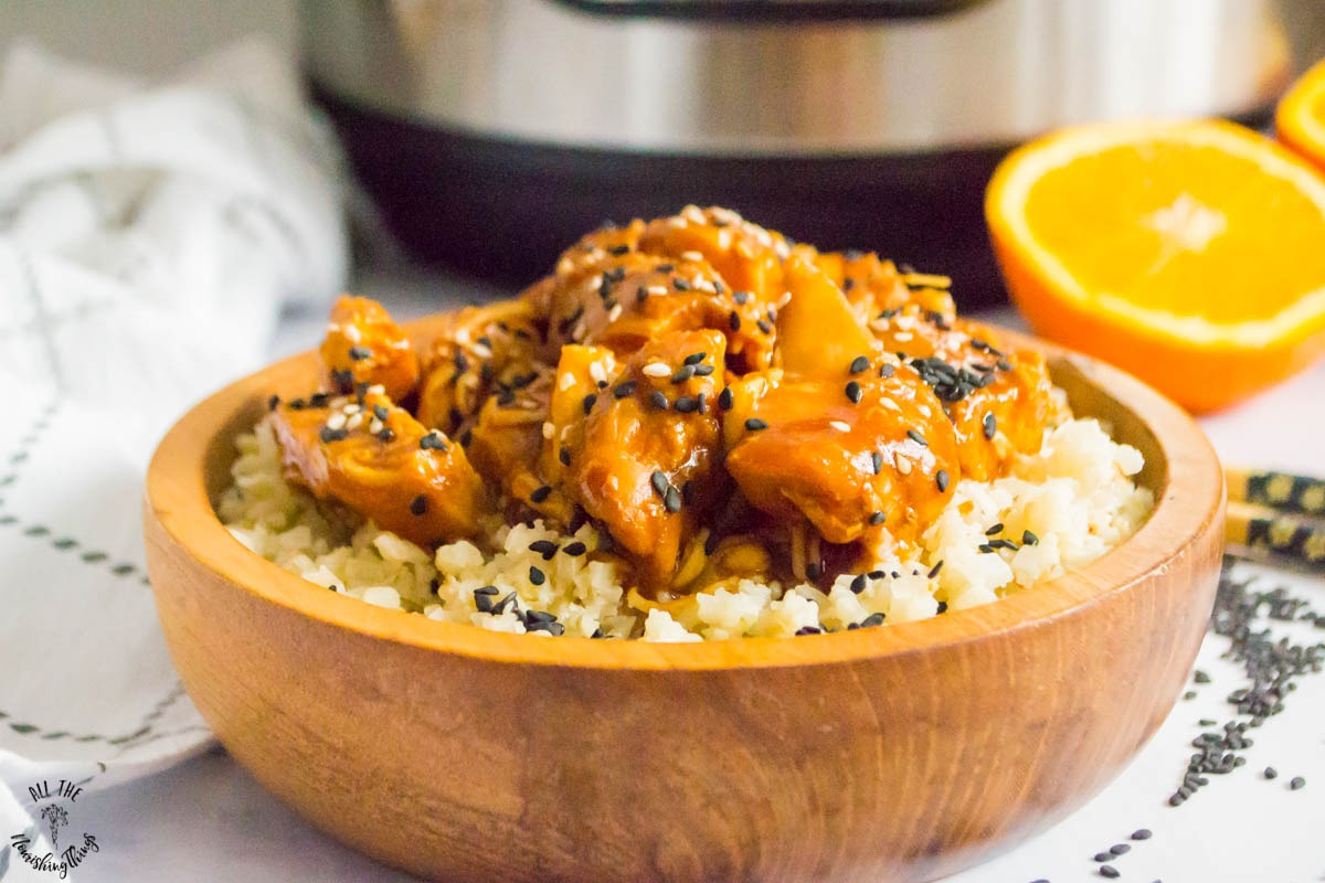 wooden bowl of keto instant pot sesame orange chicken