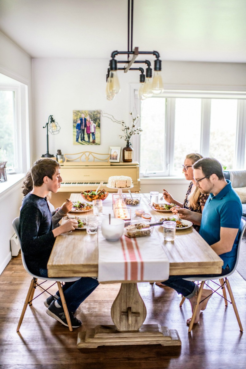 family of 4 eating at their dining room table
