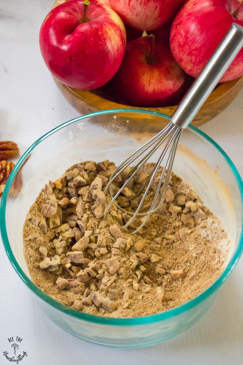 whisking together instant pot apple crumble filling ingredients