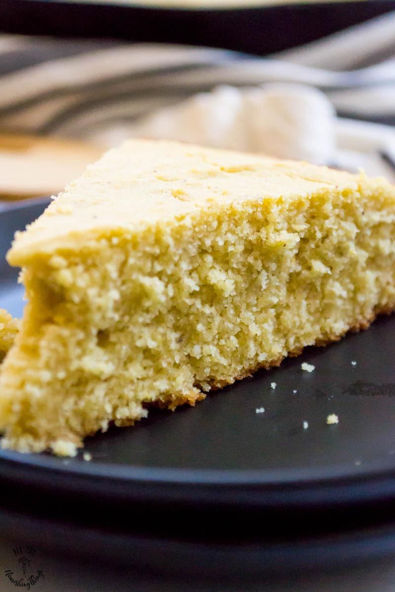 slice of gluten-free southern cornbread on black plates