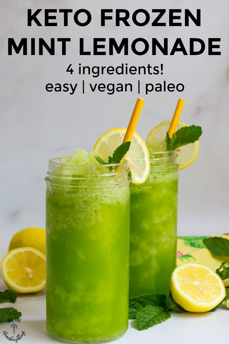 2 glasses of keto frozen mint lemonade garnished with lemon slices and text overlay over the glasses