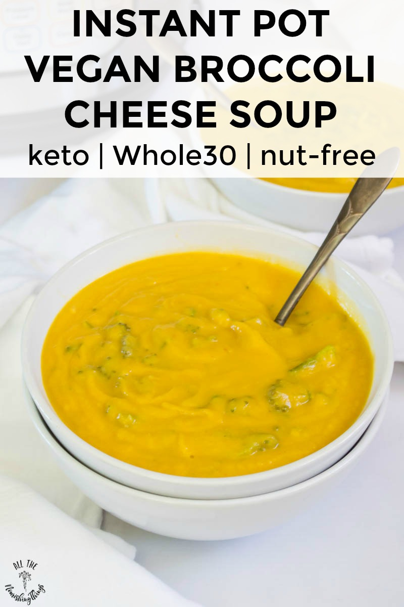white bowl of instant pot vegan broccoli cheese soup with vintage spoon and text overlay