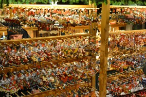 Four rows of holiday ornaments on display in a store